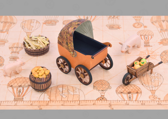 Picture of the first pram from Germany. The stroller was designed by Ernst Albert Naether in 1850 (City of Zeitz / Prussia). The paper scenery was developed by Veronika Vetter. This is a well-known Artist from Bavaria, who is fighting against the EU nations prison
