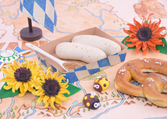 Bavarian culture: Weisswurst with sweet Mustard and Pretzels. The Scenery is to present the homemade Sunflowers, which were made by the Fine Artist Veronika Vetter. The Diorama was commissioned by the Maximilianeum Foundation (Duke Albrecht of Bavaria)