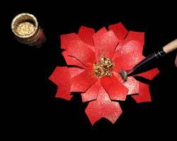 Bild von Weihnachtsstern mit Goldpulver