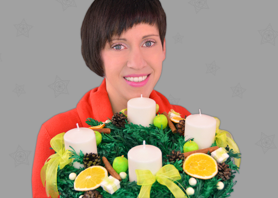 Picture of hot German Christmas Maid with Advent wreath. The wife of Santa Clause carries gifts for her Sugar Daddy