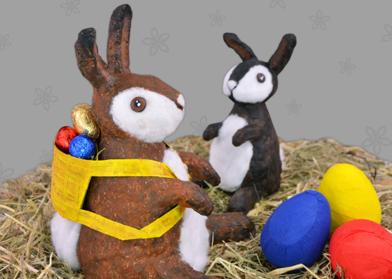 Picture of two Easter bunnies who are sitting in the hay. Created by Veronika Vetter Bavarian Fine Artist