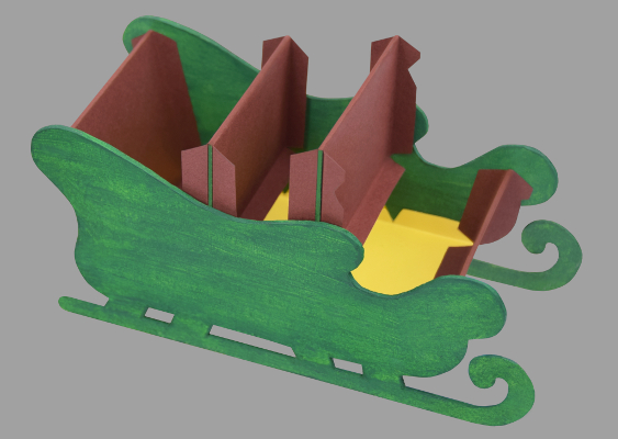 "Two Partitions turn the Paper Sled into a Snack Bowl for Nuts. The two Separators are made of Construction paper and sturdy Cardboard. The Christmas artwork was designd for the TV show ""Crafts in America"" at PBS"